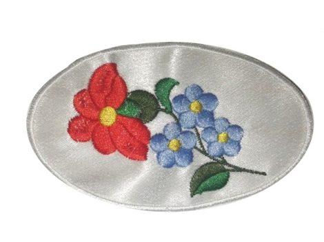 Virág mintás címke, ovális, varrható,  11,5 x 6,5 cm, 295  Ft/db  (2 db/csomag)