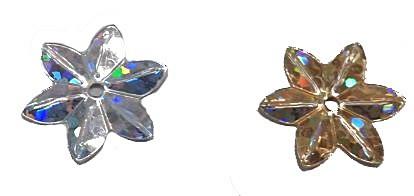 Kis virág flitter hologramos, arany vagy ezüst. 15 mm, 0,5 kg/cs. 4800  Ft / cs (1)